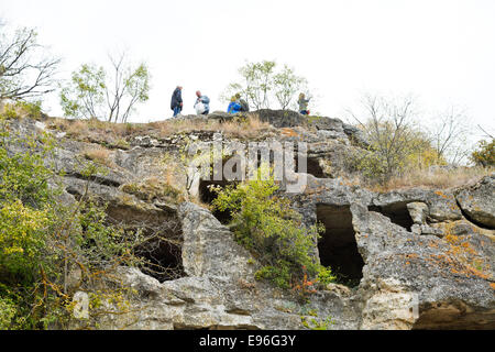 BAKHCHYSARAI, RUSSIA - OCTOBER 1, 2014: tourists on ruins medieval city Chufut-Kale. In 15th cent first Crimean - Stock Photo