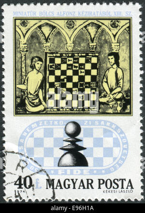 Stamp printed in Hungary, shows Chess Players from 15th Century Manuscript - Stock Photo