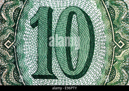 Detail from a 1936 10 Pengo Hungarian banknote showing the number ten and detailed anti-forgery security printing - Stock Photo