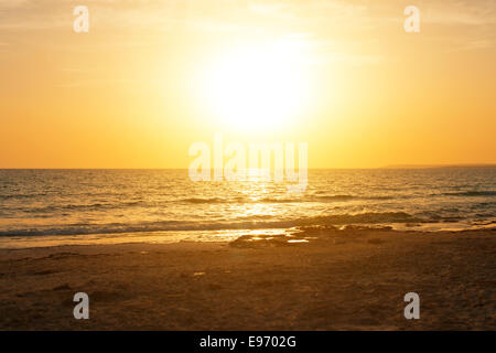 Sunset over the sea. Photograph from the beach. - Stock Photo