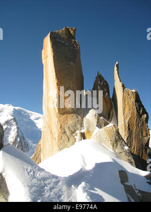 Sheer rock face used by climbers in the high alps. On the route of the famous Cosmique Arret climb above the Col - Stock Photo