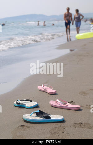 sandals pair on beach - Stock Photo