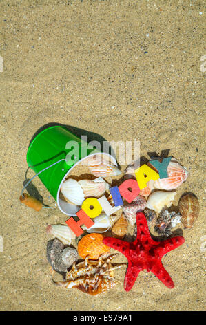 Wooden colorful word 'Holiday' on the sand - Stock Photo