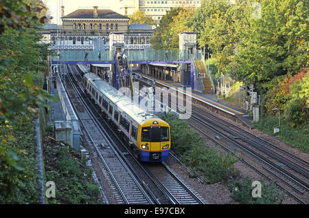 Denmark Hill railway station, south London. An Overground train pulls away. Shows new step-free access via lifts - Stock Photo