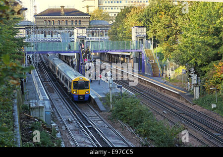 Denmark Hill railway station in south east London. An Overground train waits at the platform. Shows new lifts and - Stock Photo