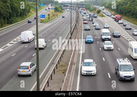 Traffic congestion with slow moving traffic and a long tailback of vehicles, Junction 25 M1 motorway, Nottinghamshire - Stock Photo