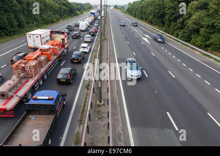 Traffic jam. Queue with vehicles at a standstill on the southbound M1 motorway carriageway with clear northbound - Stock Photo