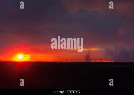 sun rise over the eruption at Holuhraun - Stock Photo