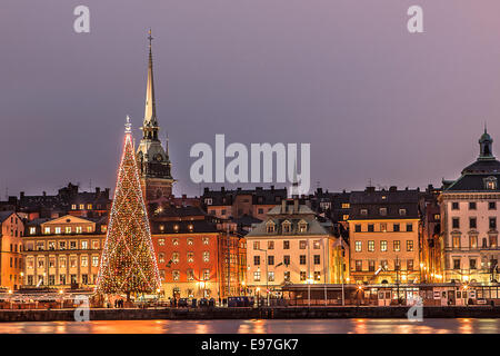 Christmas in Stockholm with the traditional famous Christmas tree. Photo taken from Skeppsbron. - Stock Photo