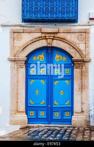 The decorated wooden door to the mosque in Sidi Bou Said, Tunisia. - Stock Photo