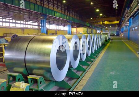 Rolls of steel sheet in steel pant - Stock Photo