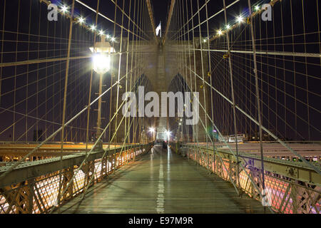 Long exposure shot taken on the Brooklyn Bridge - Stock Photo