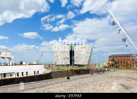 Titanic Belfast museum with the SS Nomadic steamship tender to the left, Titanic Quarter, Belfast, Northern Ireland, - Stock Photo