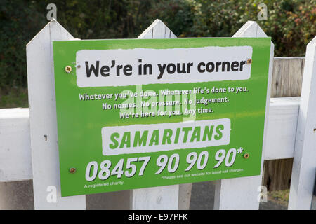 Samaritans sign at Llanfair PG station platform help for people in despair or suicidal Anglesey North Wales UK - Stock Photo