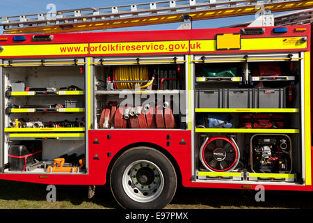 A fire engine appliance displaying equipment carried on board - Stock Photo