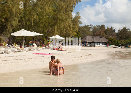 A couple on the beach Ile Aux Cerfs island, east coast, Mauritius - Stock Photo