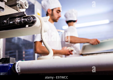Bakers making pastry dough - Stock Photo