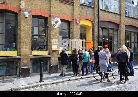 People queuing outside the Breakfast Club on Rufus Street, in trendy Hoxton, in east London, UK - Stock Photo