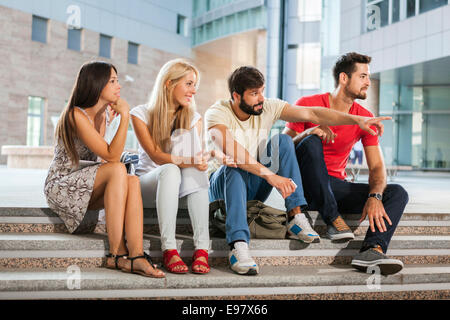Group of students on campus grounds - Stock Photo
