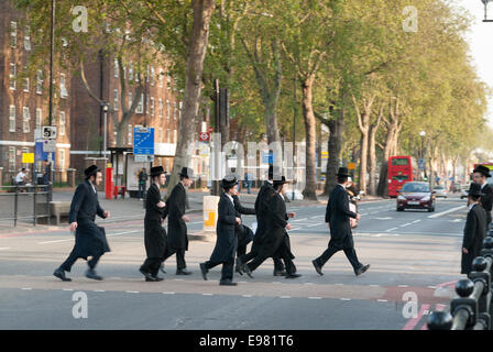 Orthodox Jews crossing the road in Stamford Hill, Hackney, London, England, UK - Stock Photo