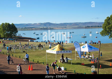 Many unknown participants and spectators gather for the On LIne Tri Series Race 1 triathlon at Midmar Dam in the - Stock Photo