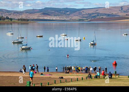 participants and spectators gather for the start of the On LIne Tri Series Race 1 triathlon at Midmar Dam in the - Stock Photo