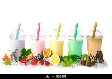 Various Bubble Tea in a row isolated on white background with different fruits. - Stock Photo