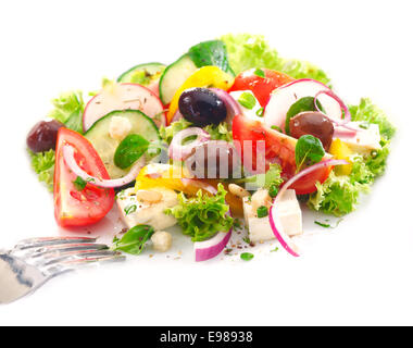 Serving of delicious Greek salad with crisp greens, feta, olives, tomato and onion garnished with orange peel - Stock Photo