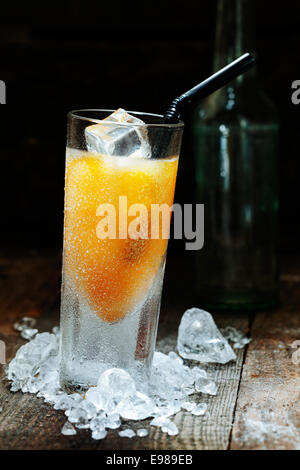 Cool Mango Alcohol Drink with crushed Ice on wooden table for drink concepts - Stock Photo