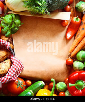 Garden fresh vegetables and blank brown paper - Stock Photo