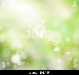 Relaxing blurred green glowy background with light bubbles - Stock Photo