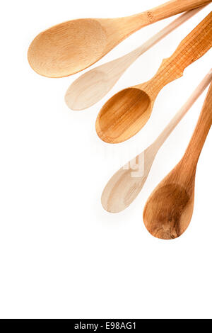 Close-up of different kinds of wooden kitchen utensils isolated on white background - Stock Photo