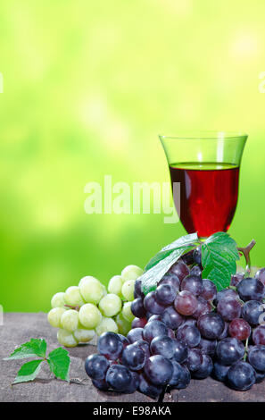 Blue grapes against a blue background Stock Photo, Royalty ...