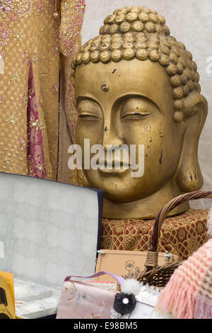 Stall with the head of a Golden Buddha and Bric and Brac - Stock Photo
