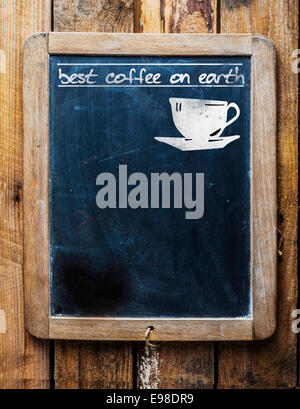 Old restaurant or coffee house menu on a rustic weathered old vintage school slate with a silhouette of a cup and - Stock Photo