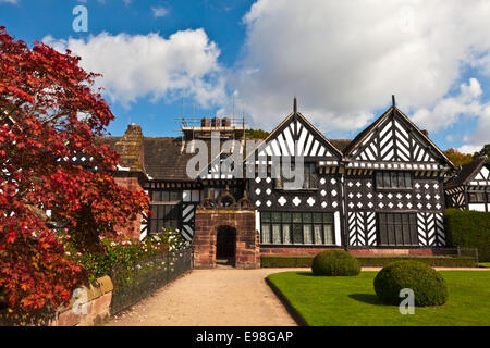 Black and white timber framed medieval mansion house and gardens. - Stock Photo