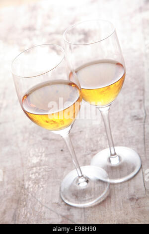 Two Champagne in Glasses on Wooden Table Ready to Serve for Partners. Good for Lowering Blood Pressure. - Stock Photo