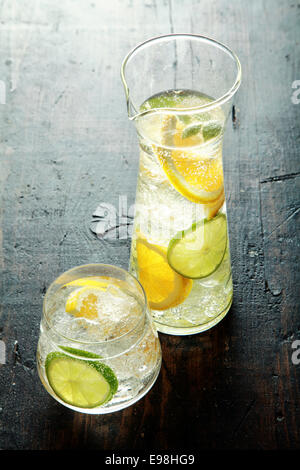 Healthy Water with Fresh Lemon Inside on Wooden Table. Good Source for Vitamin C - Stock Photo