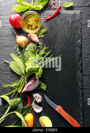 Black Chopping Board, Ingredients on Side, Isolated Black Wooden Table - Stock Photo