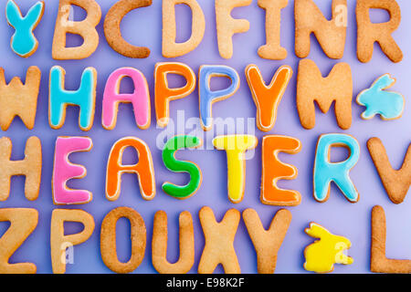 Happy Easter Card On Textured Purple. Words HAPPY EASTER on a textured purple background, festive card for Easter - Stock Photo