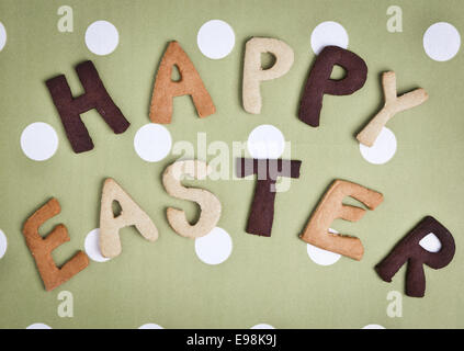 Happy Easter Card On grey green fabric. Words HAPPY EASTER on a tureen fabric background, festive card for Easter - Stock Photo