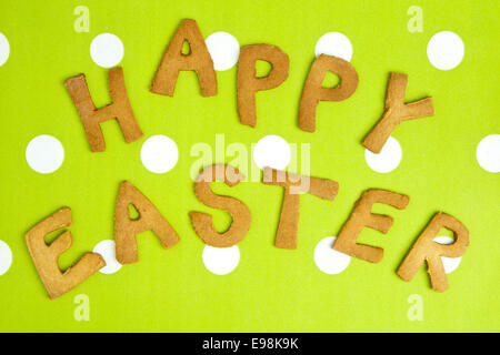 Happy Easter Card On green fabric. Words HAPPY EASTER on a tureen fabric background, festive card for Easter holiday. - Stock Photo