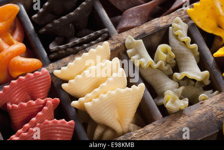 Different colored Pasta in an old letter-box - Stock Photo