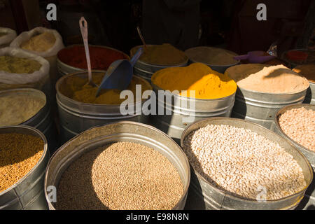 Large containers with exotic spices and pulses at a stall in the souk market within the Medina, Marrakech, Morocco, - Stock Photo
