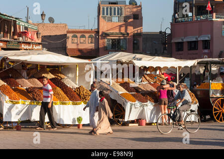 Fruit and spice stalls on the  Djemaa El-Fna market square in the medina of Marrakesh, Morocco, North Africa - Stock Photo