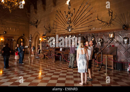 UK, England, Warwickshire, Warwick Castle, visitors in the Great Hall - Stock Photo