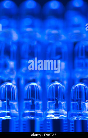 close up of row of light led light emitting diodes as part of a lighting circuit with anode and cathode - Stock Photo