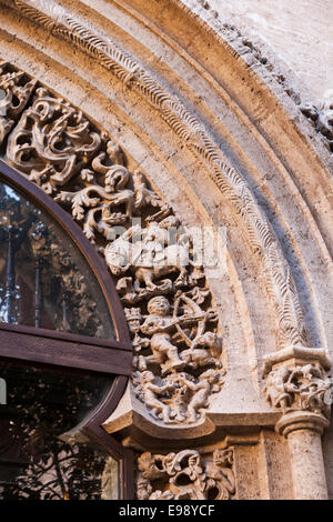 Detail of allegorical figures carved in stone at the Silk Exchange building in Valencia, Spain. - Stock Photo