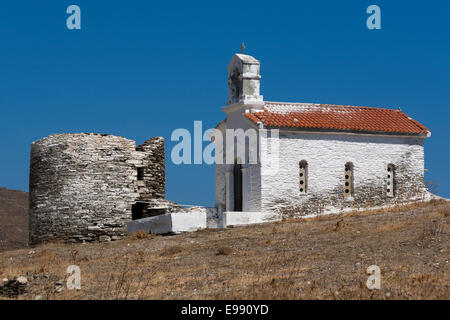 Greece, Cyclades, Andros, Ormos Korthiou, chapel & ruined tower - Stock Photo