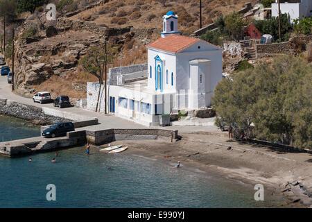 Greece, Cyclades, Andros, Ormos Korthiou, church & beach - Stock Photo